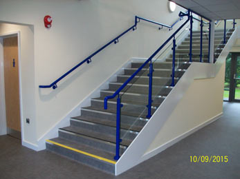 Steel balustrade system with glass infills and nylon coated finish