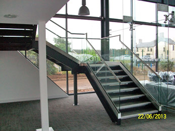 Architectural Staircase with stainless steel balustrade with glass infills